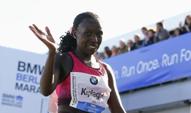 Kiplagat of Kenya reacts after winning the 40th Berlin marathon